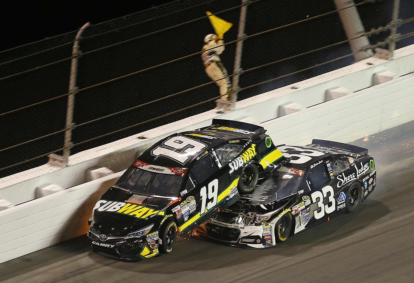Brian Scott gives Carl Edwards a piggy back during Sunday's race at Daytona.