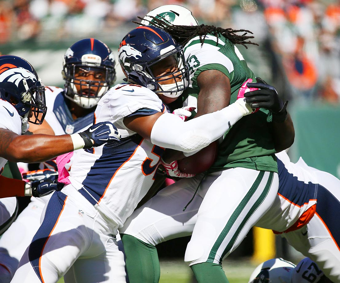 New York Jets running back Chris Ivory is taken down by the Broncos. The Broncos won 31-17.