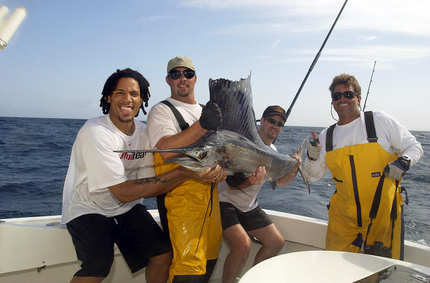 Brian Grant of the Miami Heat savors the moment after winning an hour-long fight with a sailfish off the coast of Florida.