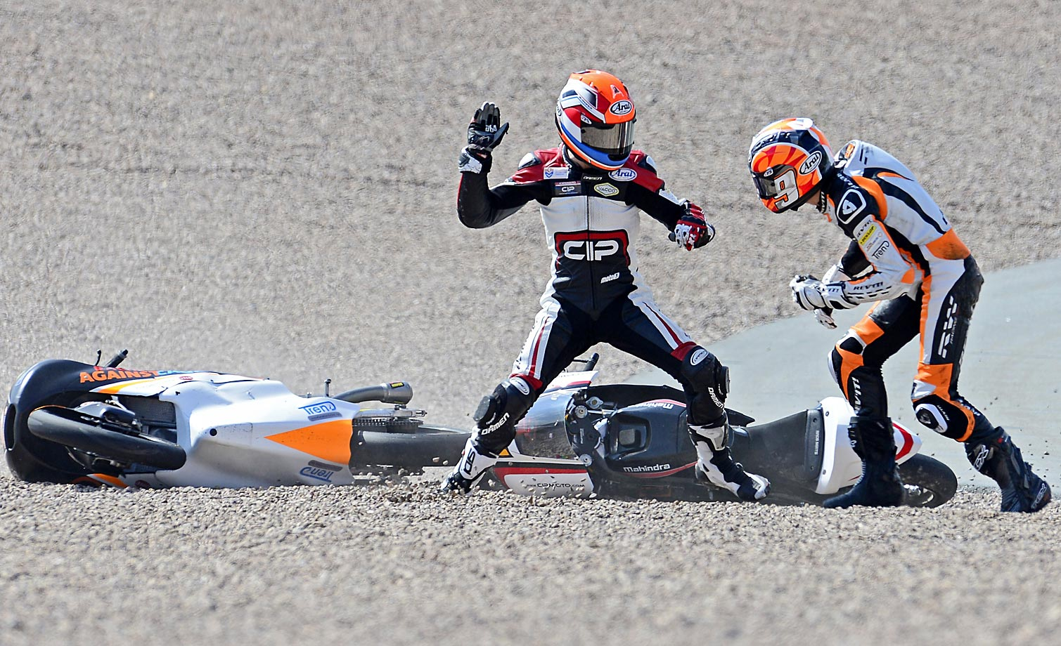 Mahindra rider Bryan Schouten of Netherlands (left) and his compatriot, Kalex KTM rider Scott Derouse, fight after crashing in the Moto3 race of the Grand Prix of Germany at the Sachsenring Circuit on July 13, 2014 in Hohenstein-Ernstthal, Germany.