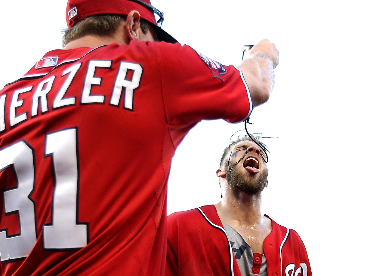 Nationals righthander Max Scherzer dumps chocolate sauce on Bryce Harper after the outfielder hit a walk-off homerun against the Braves.