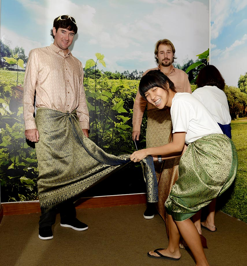 Bubba Watson and Victor Dubuisson are fitted out in traditional Thai clothing at the Queen Sirikit Textile Museum ahead of the Thailand Golf Championship.