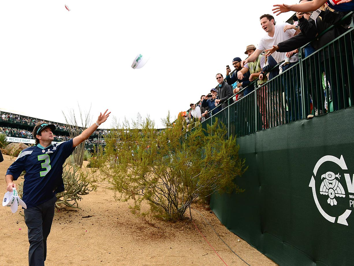 Bubba Watson dishes out swag on hole 16 while wearing a Seahawks Russell Wilson Jersey.