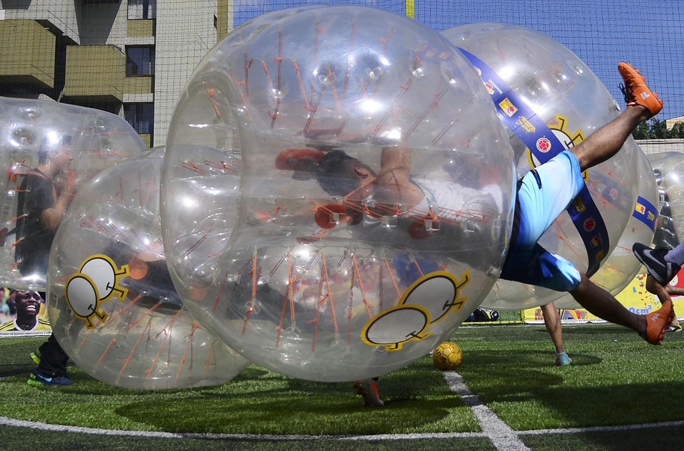 People in bubble balls play a five-on-five game of bubble-soccer in Medellin, Colombia.  Bubble-soccer is already played in over 20 countries and has professional leagues around the world.