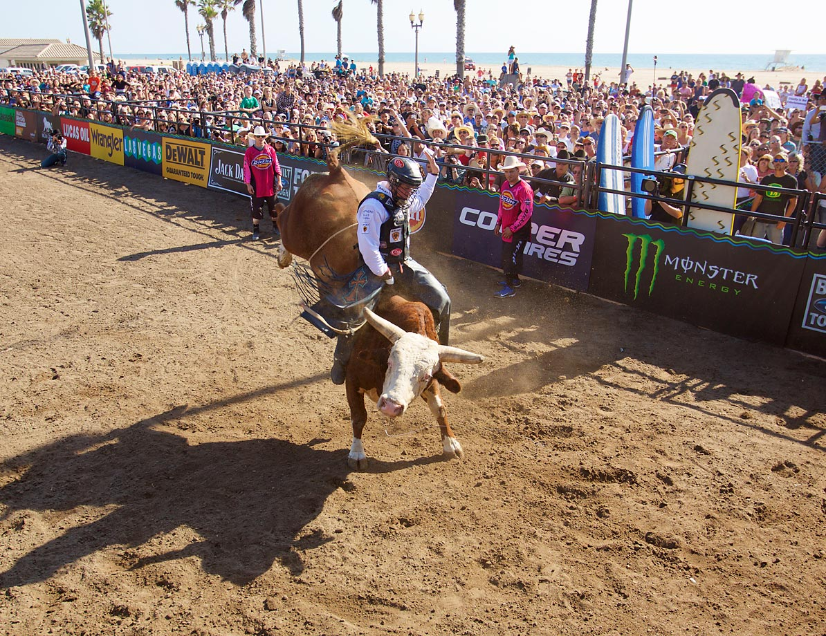 "Matt Triplett on Oklahoma Bell during the Huntington Beach ""Bulls on the Beach"" stop of the Professional Bull Riders."