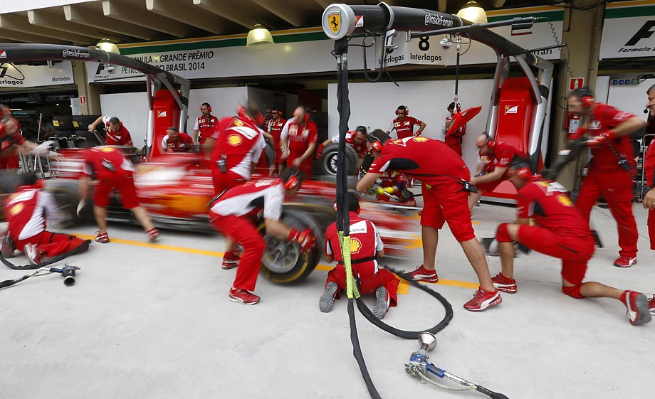 The Ferrari team practices its pit stops before the Formula One Brazilian Grand Prix.
