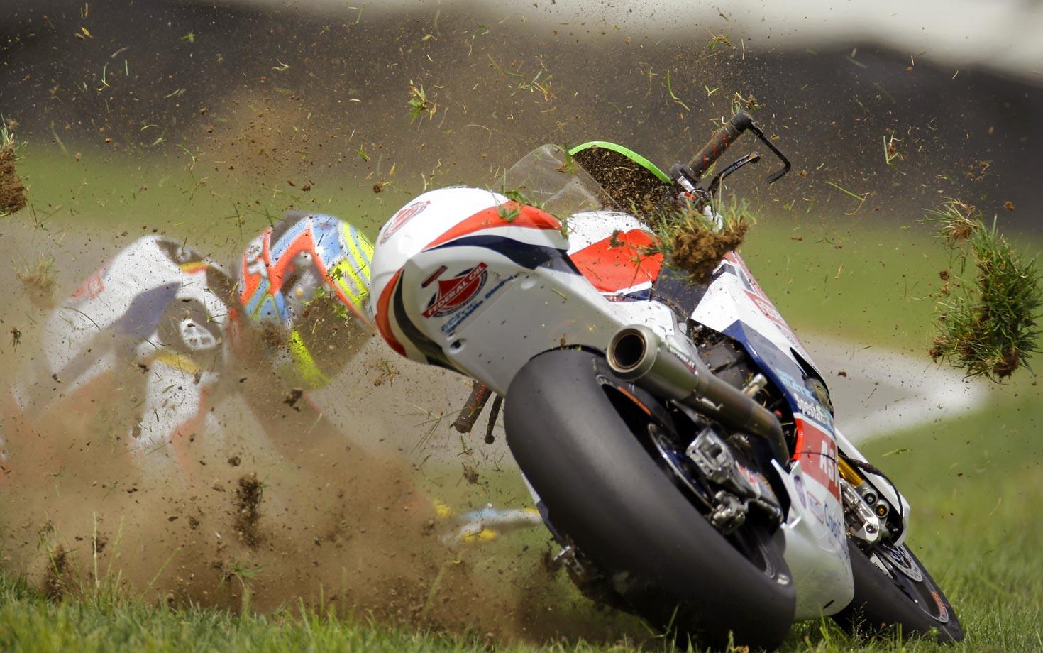 Xavier Simeon of Belgium crashes during the Indianapolis Moto 2 race in Indianapolis on Sunday, Aug. 17.