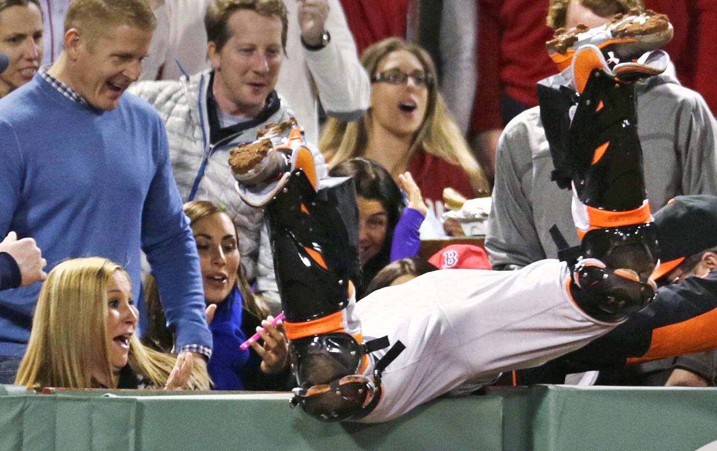 Baltimore Orioles catcher Caleb Joseph dives into the stands but cannot make the play on a foul ball hit by David Ortiz.