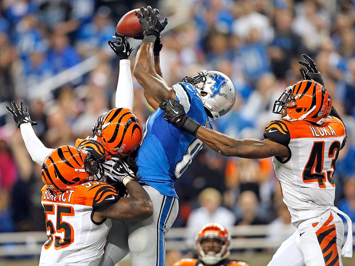 2013:  Calvin Johnson outjumps three Cincinnati defenders in end zone for a 50-yard TD for Detroit.
