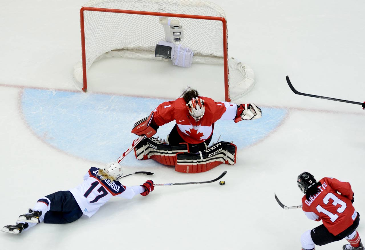 Shannon Szabados of Canada makes a save on an attempt by Jocelyne Lamoureux.