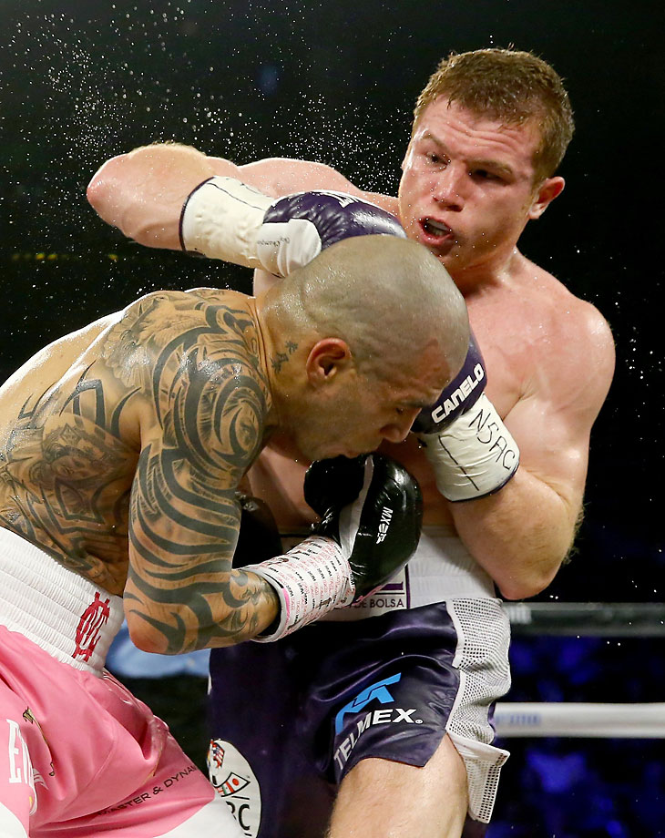 "Saul ""Canelo"" Alvarez (right) defeated Miguel Cotto by unanimous decision on Nov. 21 to become the WBC world middleweight champion."