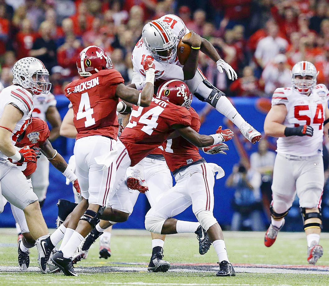 Ohio State quarterback Cardale Jones leaps over Alabama defensive back Geno Smith in the Sugar Bowl NCAA college football playoff semifinal game in New Orleans.