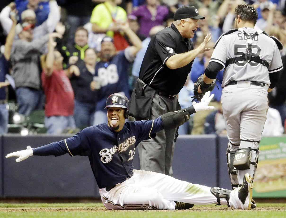 Brewers centerfielder Carlos Gomez calls himself safe after hitting a triple and scoring on a throwing error in the fifth inning of a 10–7 win over the White Sox.