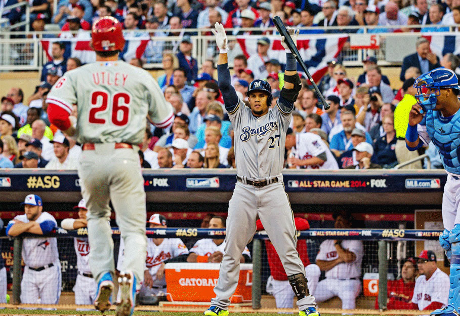 Carlos Gomez (27) welcomes home Chase Utley after scoring on Jonathan Lucroy's RBI double.
