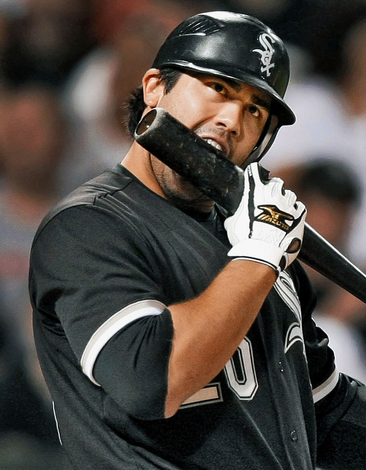 White Sox outfielder Carlos Quentin digs into his bat during a game against the Mariners.