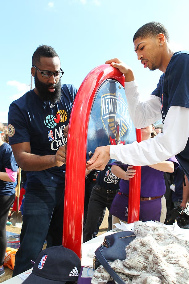 Caron Butler and James Harden help put together a sign at the KIPP Leadership Academy in New Orleans during the NBA Cares All-Star Day of Service.