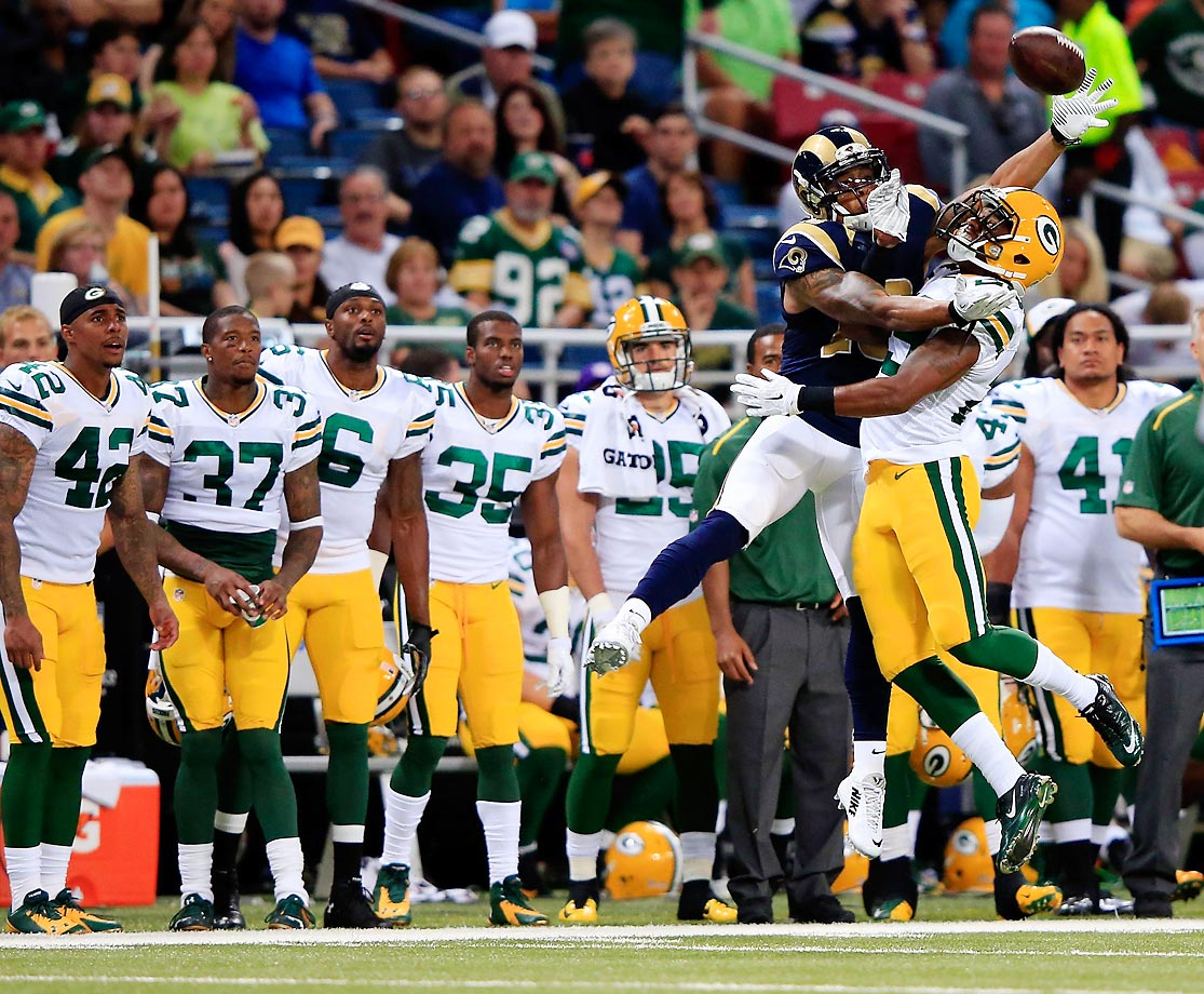 Casey Hayward of the Packers breaks up a pass intended for Austin Pettis of the Rams during the preseason game at the Edward Jones Dome.