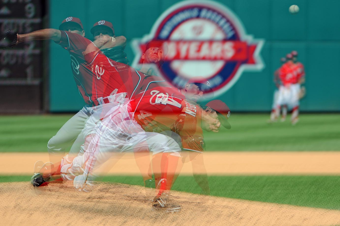 Multiple exposure photo of Casey Janssen of the Washington Nationals in a game against the Colorado Rockies.