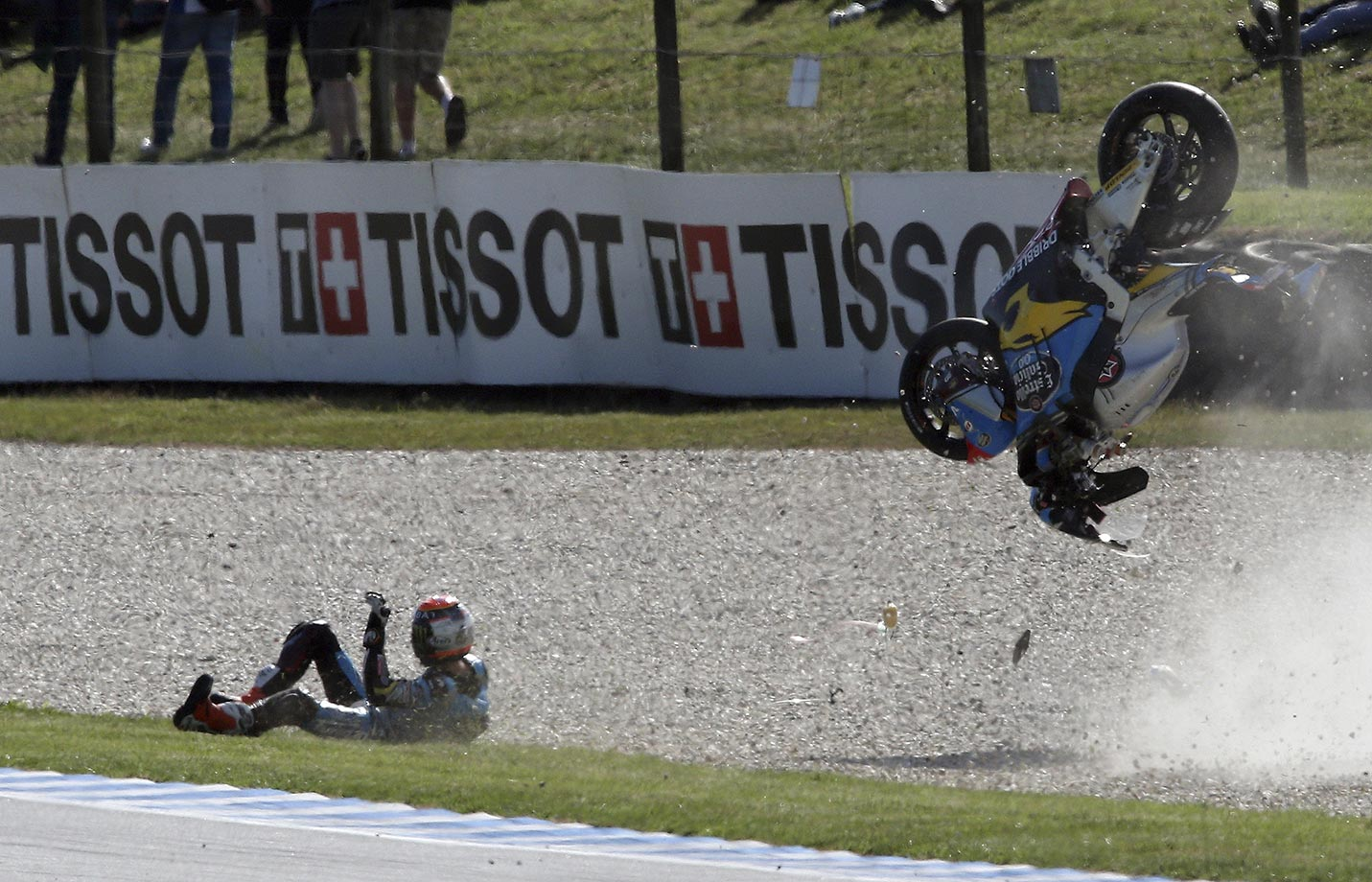 Moto2 rider Tito Rabat of Spain crashes on the exit to turn 11 during free practice for the Australian Motorcycle Grand Prix.