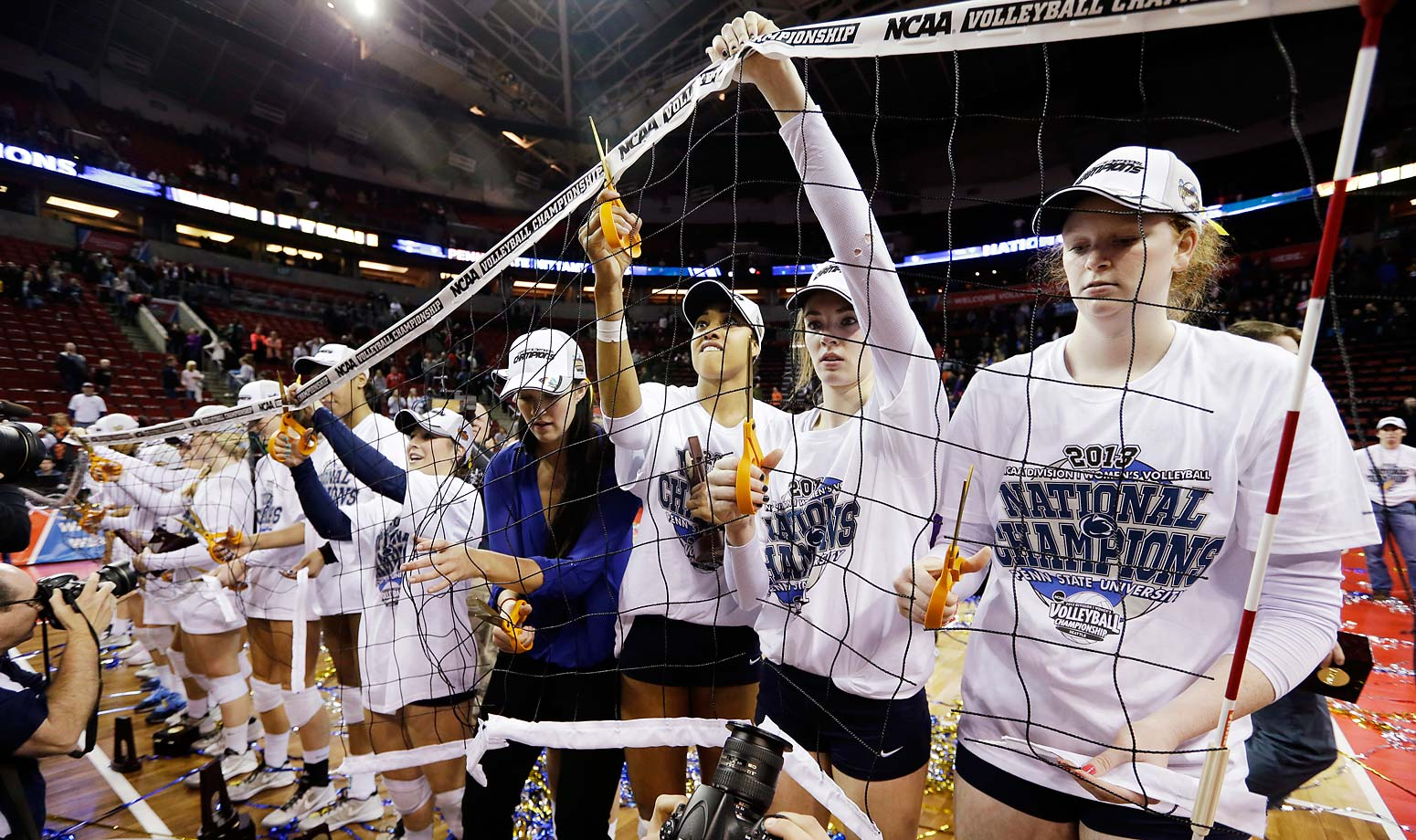 Penn State players cut down the net after the women's team won their sixth national championship, including their fourth in a row.
