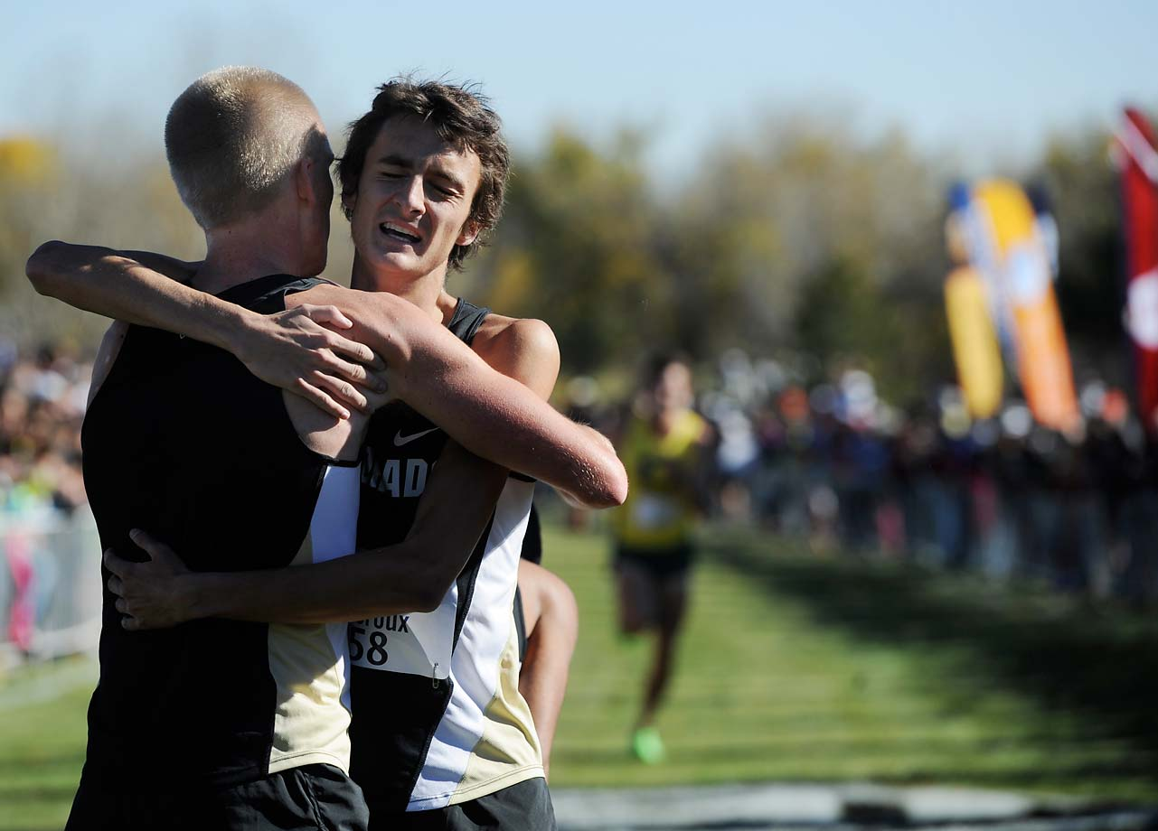 Blake Theroux embraces Connor Winter as the two Colorado teammates helped the school win the Men's Cross Country National Championship.