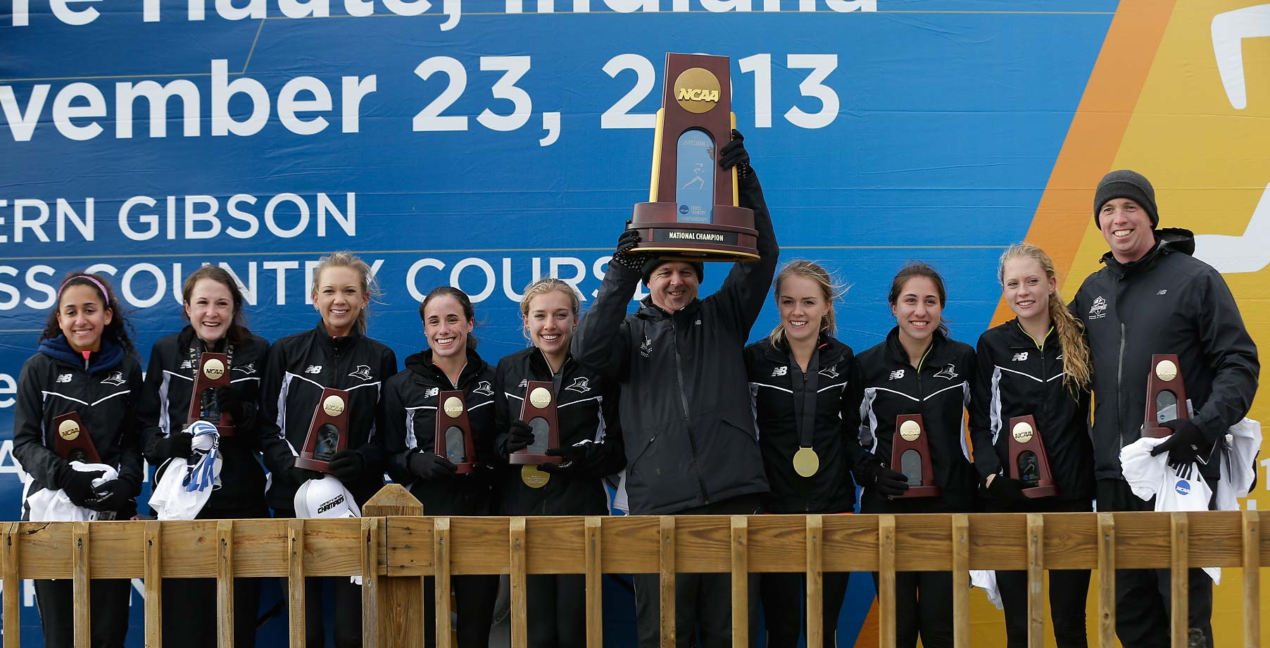 Providence lines up to take its celebratory picture after winning the Women's Cross Country National Championship, a welcome sight for the team after finishing second the year before.