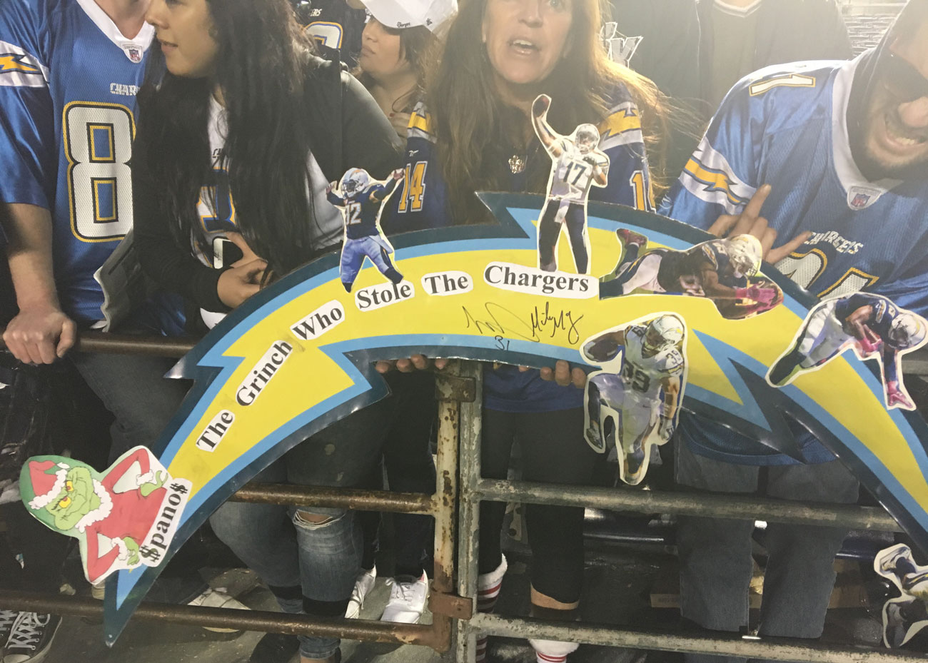 Chargers fans show a sign berated Dean Spanos at the 2015 home finale.
