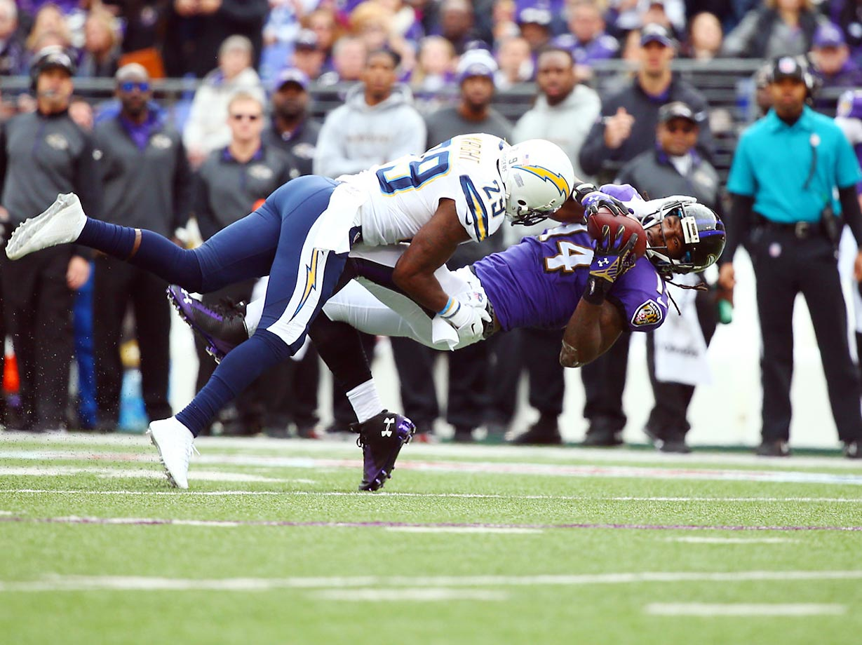 Ravens receiver Marlon Brown tries to hang on to the catch as Chargers cornerback Shareece Wright defends.