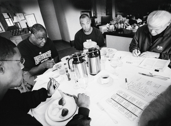 Hornets assistant coaches Stephen Silas, Jerry Eaves and Lee Rose with Paul Silas :: Lynn Johnson/SI