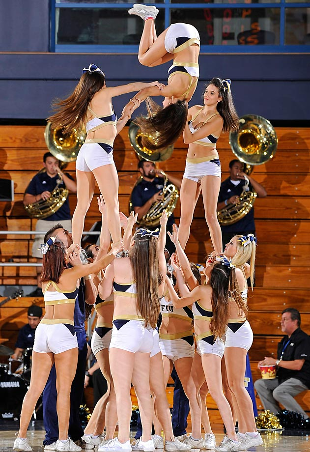 FIU's cheerleaders fire up the crowd in the first half. The Golden Panthers defeated the University of Central Florida 66-57.