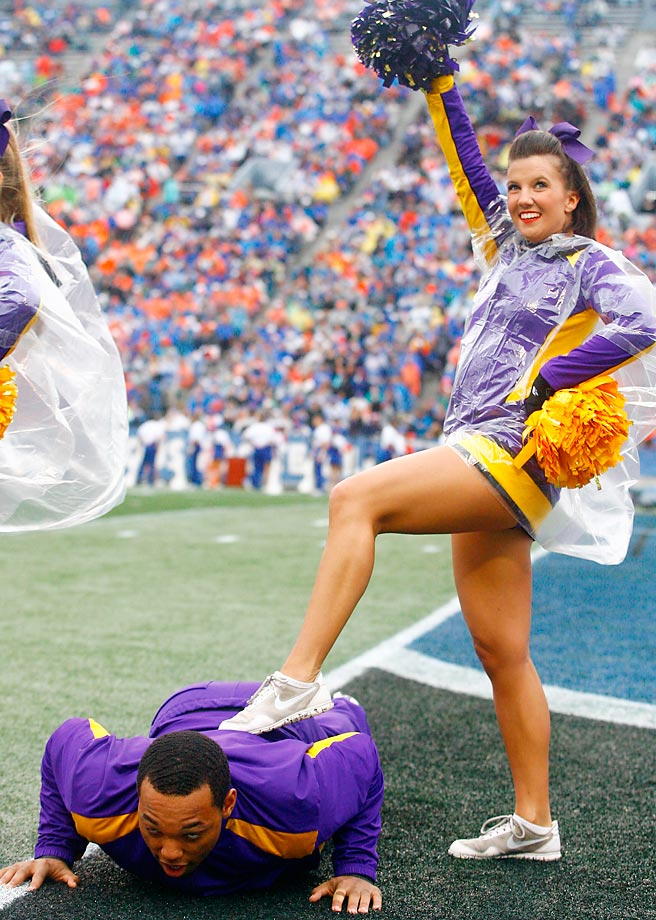 An East Carolina Pirates cheerleader celebrates possibly a little too hard after a touchdown.