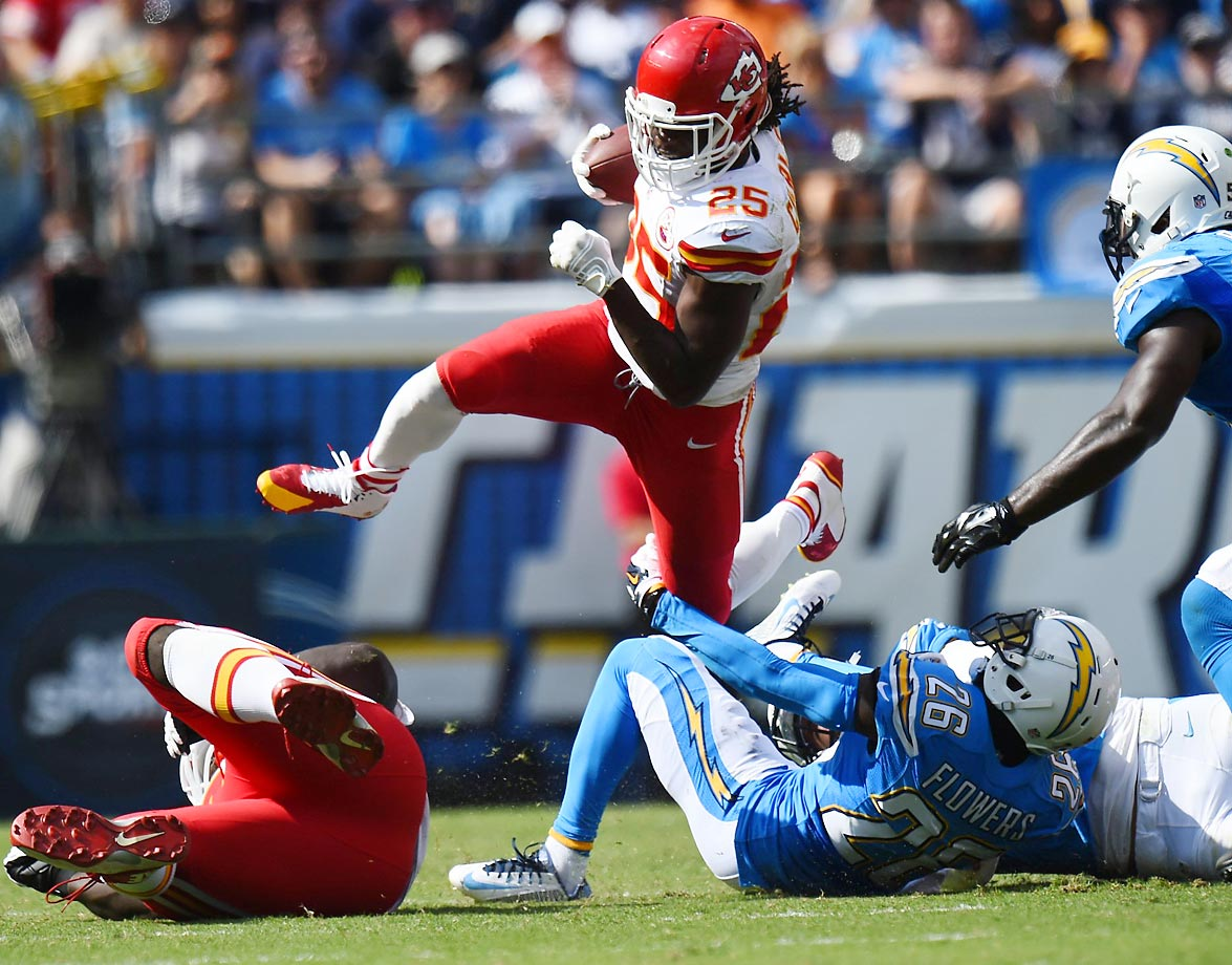 Kansas City Chiefs running back Jamaal Charles leaps over defenders in the Chiefs' 23-20 win over the San Diego Chargers.