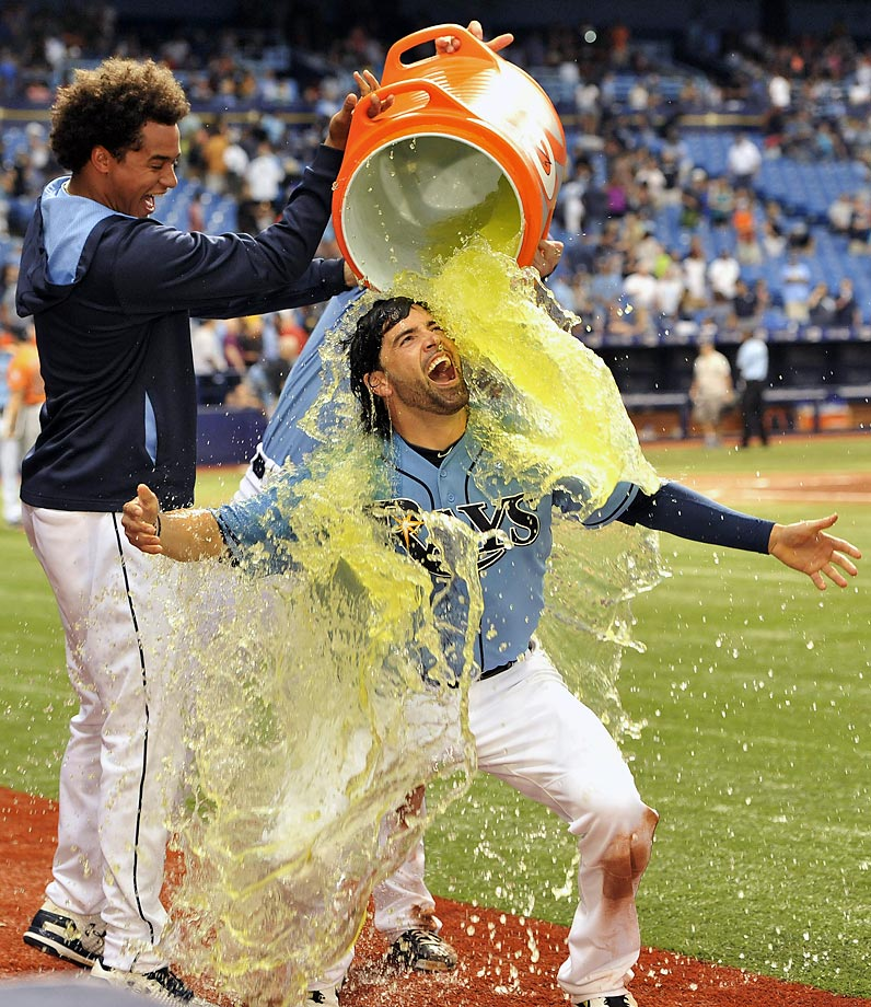 Chris Archer of the Tampa Bay Rays douses David DeJesus after a 4-3 win over the Houston Astros.