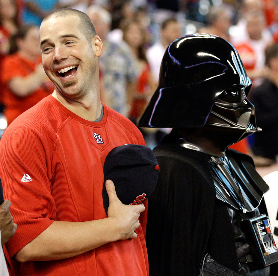 "St. Louis Cardinals pitcher Chris Carpenter laughs as he stands with Darth Vader before the National Anthem prior to the Cardinals game against the Houston Astros on Sept. 26, 2011 on ""Star Wars Night"" at Minute Maid Park in Houston."