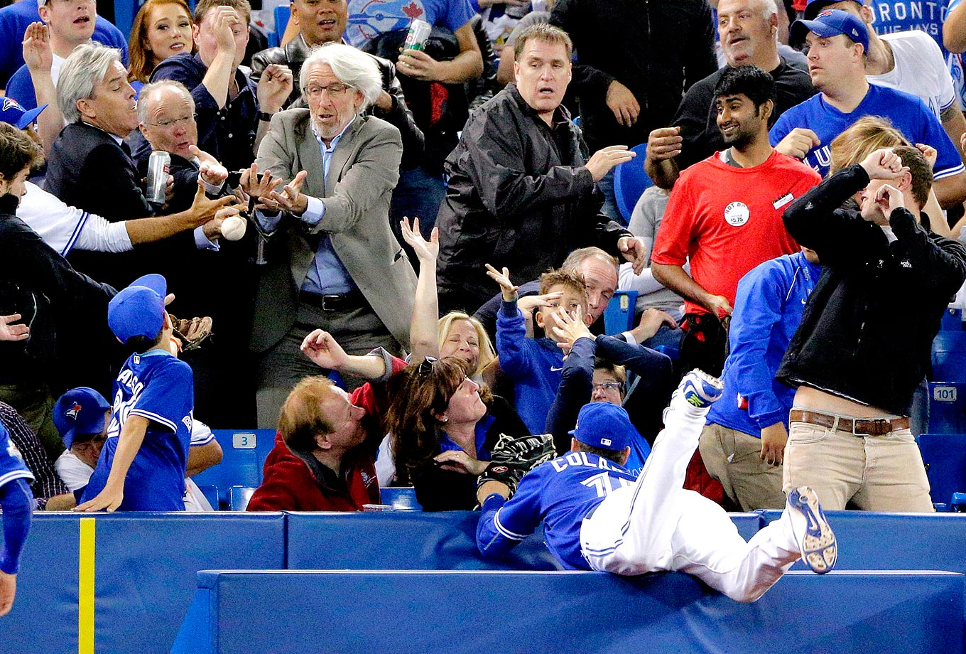 Chris Colabello of the Toronto Blue Jays misses this foul ball against the Royals.