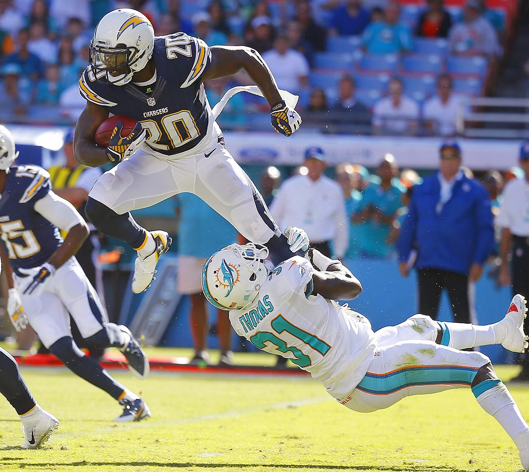 Chargers kickoff returner Chris Davis is snagged by Miami's Michael Thomas. The Dolphins won 37-0.
