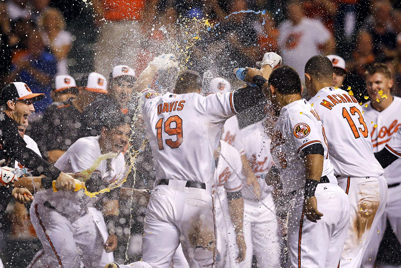 Chris Davis of the Baltimore Orioles is greeted as he crosses home plate after hitting a solo home run during the 11th inning to beat the Tampa Bay Rays 7-1 on Sept. 2.  Here are the other players who've gone yard this year to end a game.