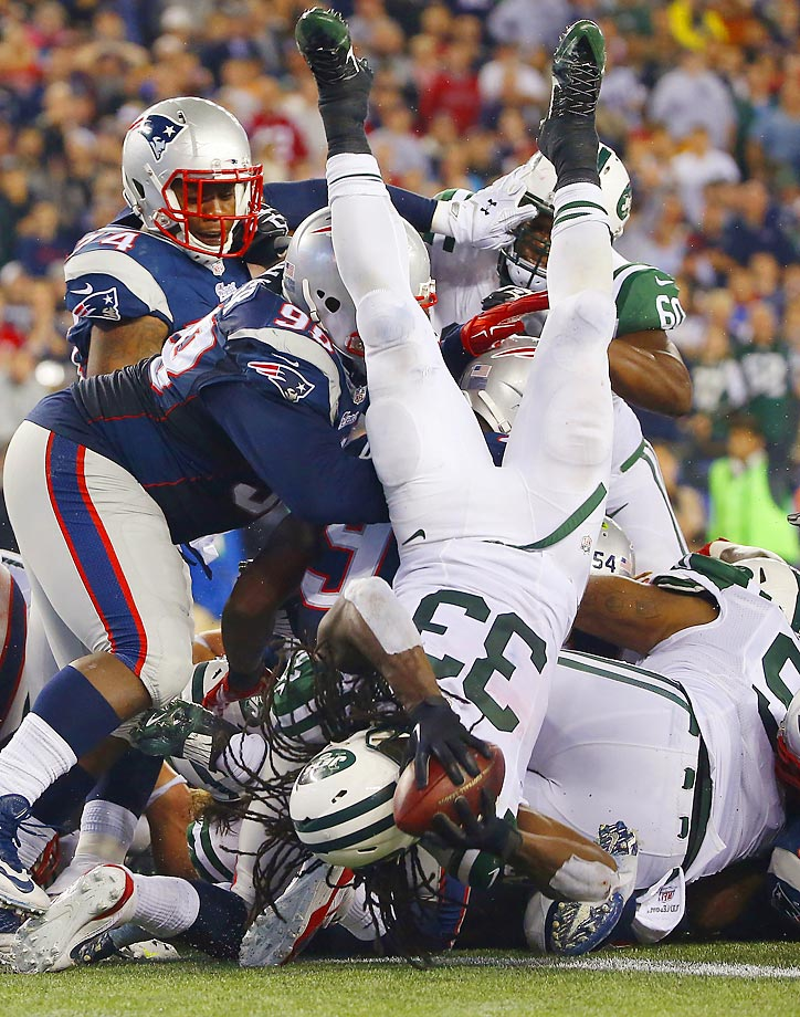 New York Jets running back Chris Ivory lands in the end zone for a touchdown against the New England Patriots. The Patriots won 27-25.