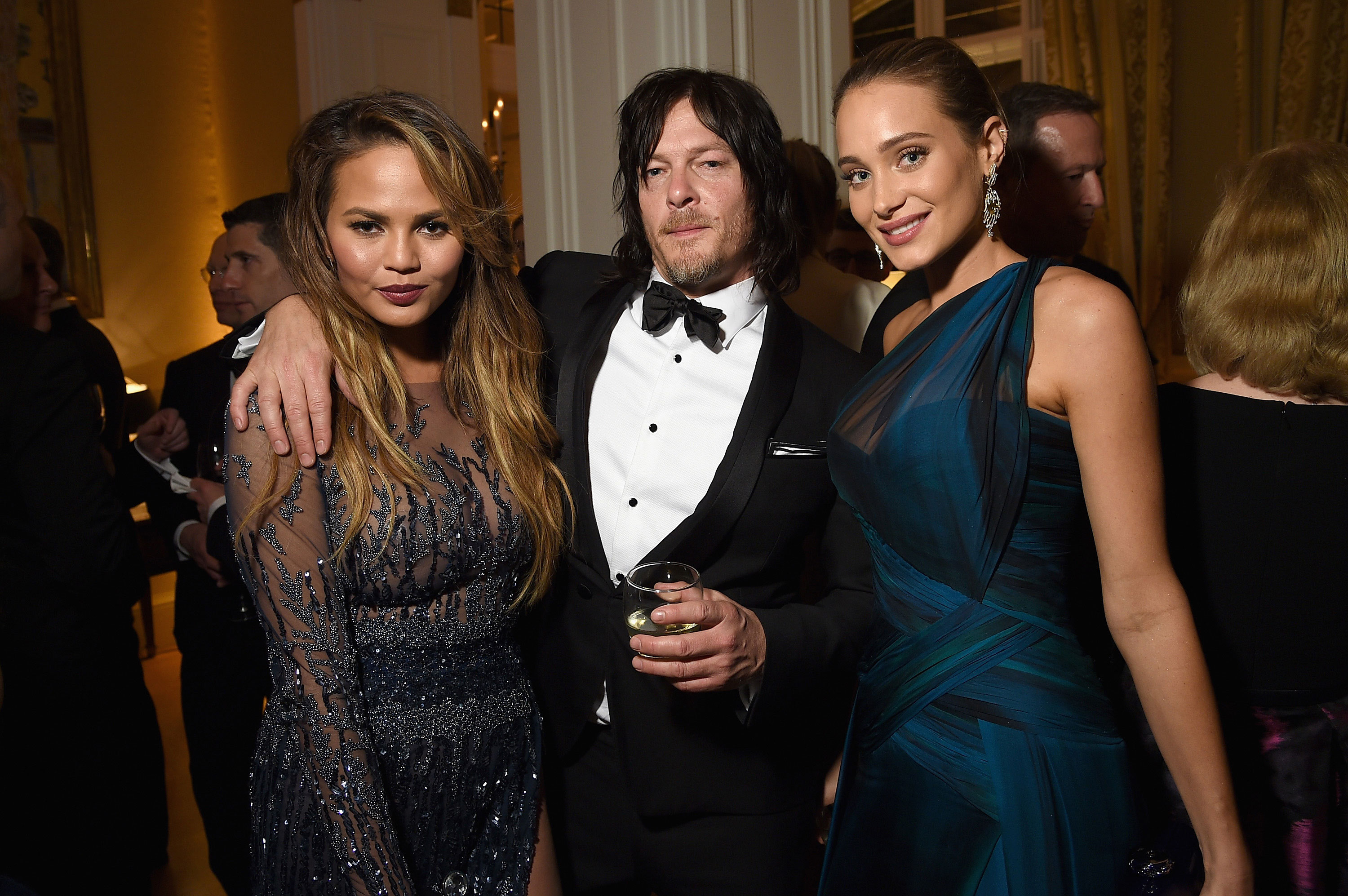 Chrissy Teigen, actor Norman Reedus and Hannah Davis attend the Bloomberg & Vanity Fair cocktail reception following the 2015 WHCA Dinner.