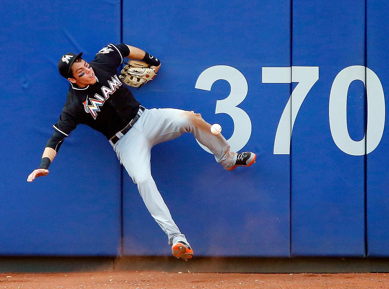 Christian Yelich of the Miami Marlins couldn't grab this ball hit by Curtis Granderson of the New York Mets.