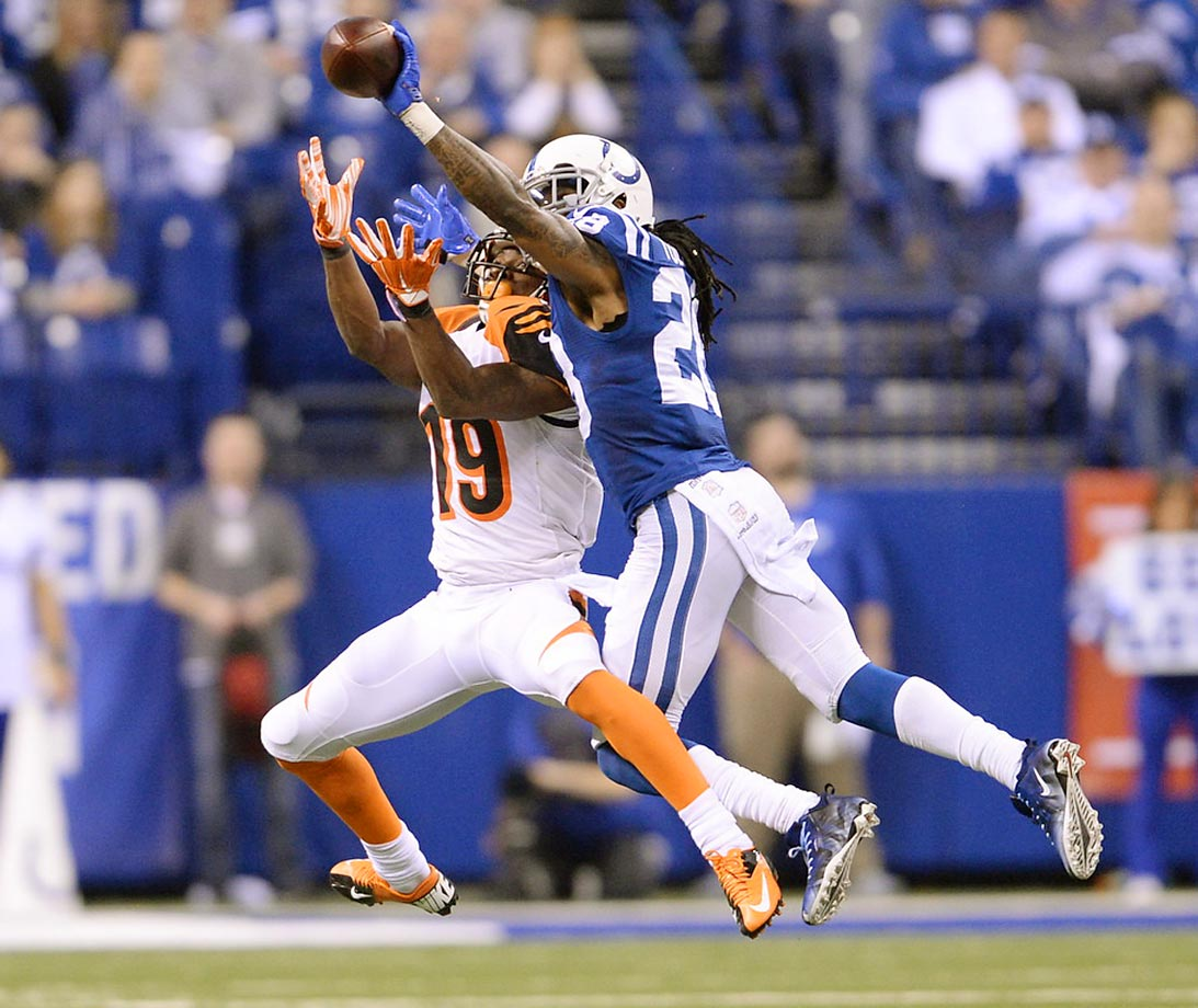 Indianapolis Colts cornerback Greg Toler tries to knock the ball away from a Cincinnati Bengals receiver during an AFC WIld Card playoff game.