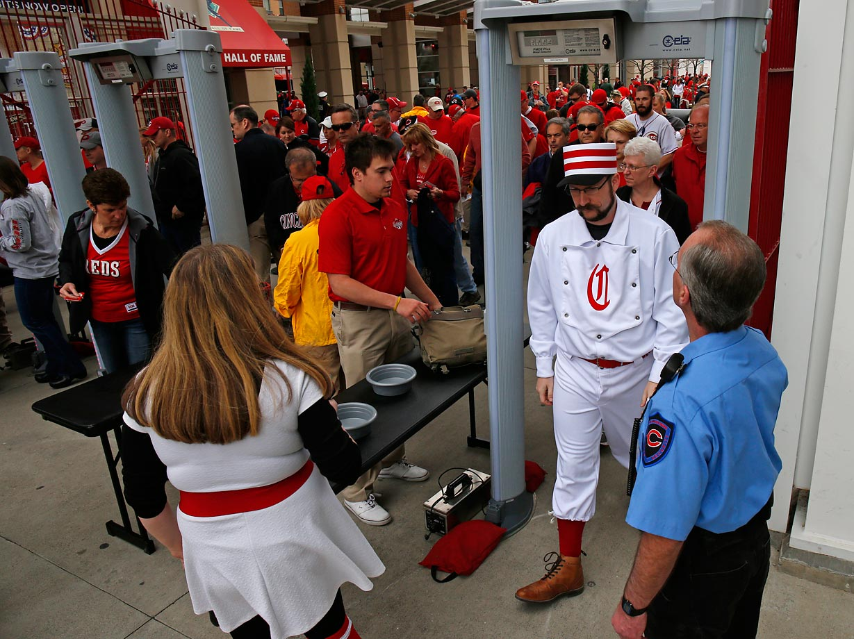 Fans enter Great American ball park before the start of the Cincinnati Reds-Pittsburgh Pirates Opening day. Metal detectors are now in use at all Major League ball parks.