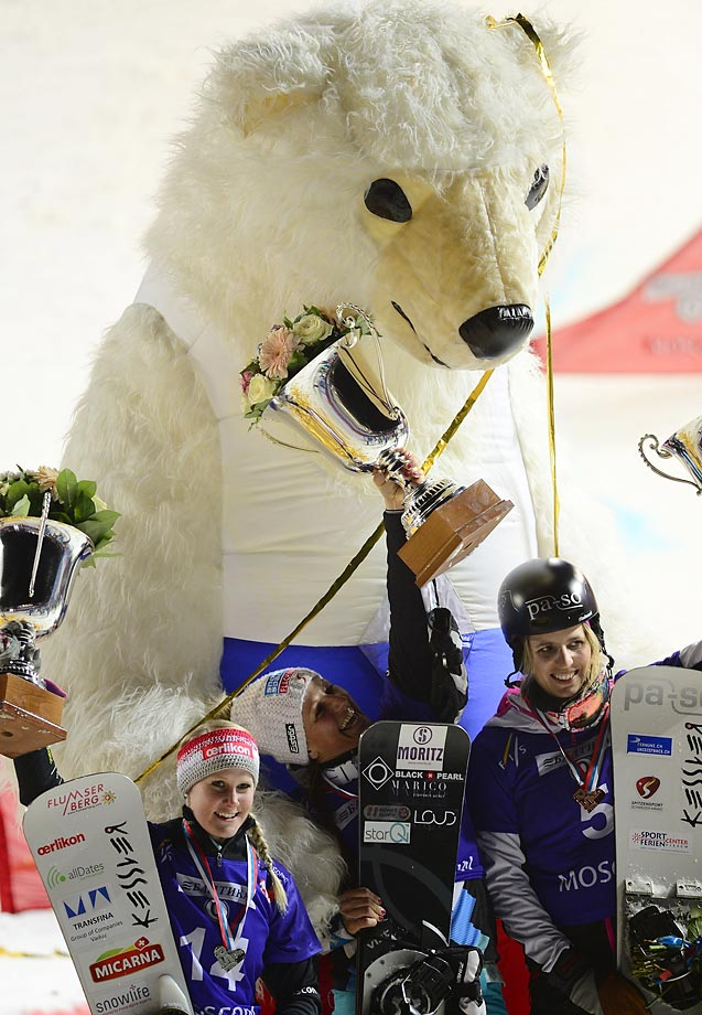 A giant bear hovers over Claudia Riegler (center), Julie Zogg (left) and Patrizia Kummer at the Parallel Slalom Snowboard qualification in Moscow.