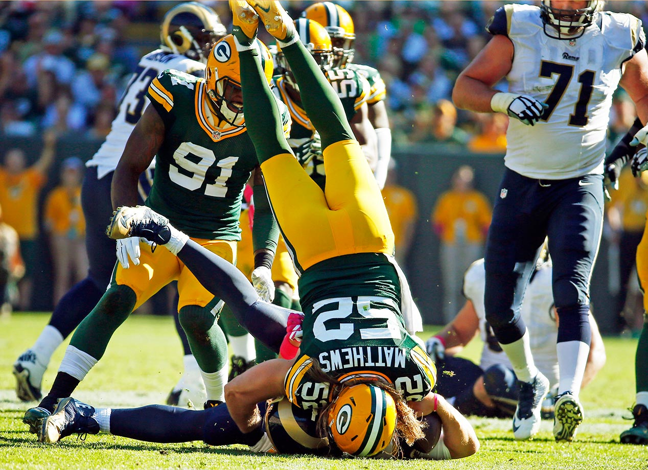 Clay Matthews of the Green Bay Packers sacks Nick Foles of the Rams in the second half. The Packers won 24-10.
