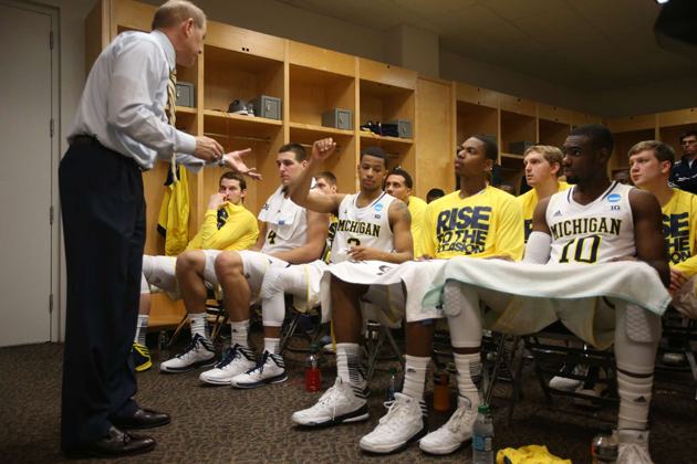 Tim Hardaway Jr. and his teammates listen to head coach John Beilein in the locker room during the second round of the NCAA Tournament in 2013.