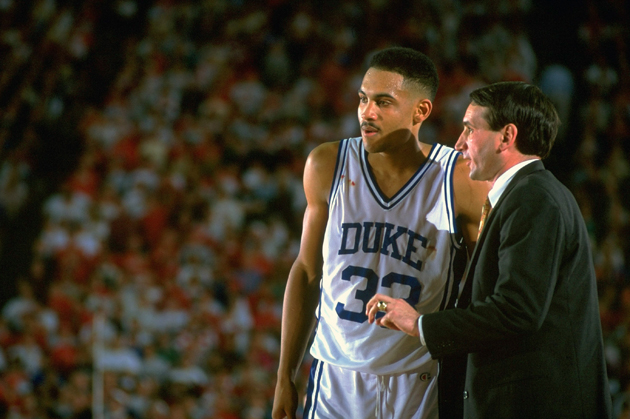 Duke coach Mike Krzyzewski talking to player Grant Hill during a game against the Indiana Hoosiers at H.H. Humphrey Metrodome during the 1992 NCAA National Semifinals.