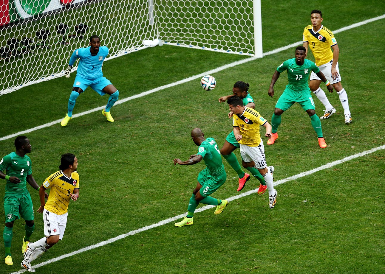 James Rodriguez of Colombia scores his team's first goal of the match past goalkeeper Boubacar Barry of the Ivory Coast on a header.
