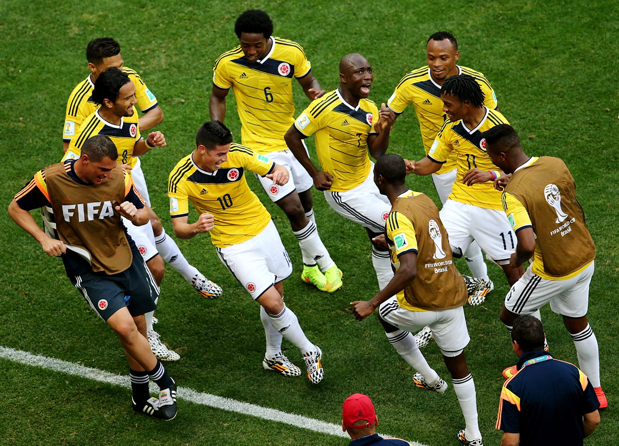 James Rodriguez (10) of Colombia and teammates dance and celebrate after Rodriguez notches his team's first goal during the  Group C match between Colombia and Cote D'Ivoire.