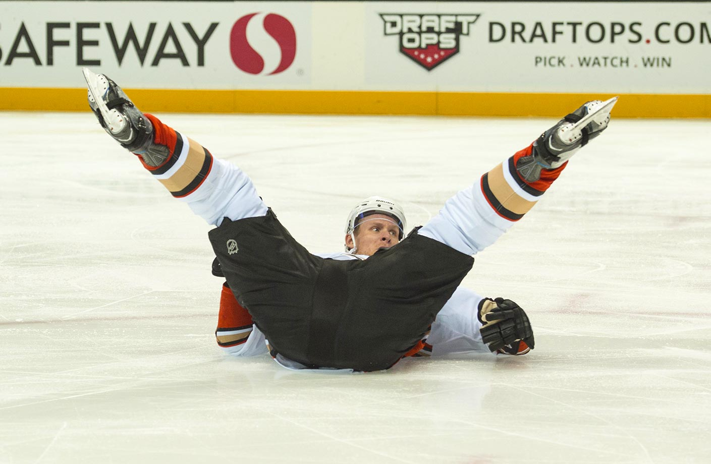 Corey Perry of the Anaheim Ducks gets tripped up in a game against the San Jose Sharks.