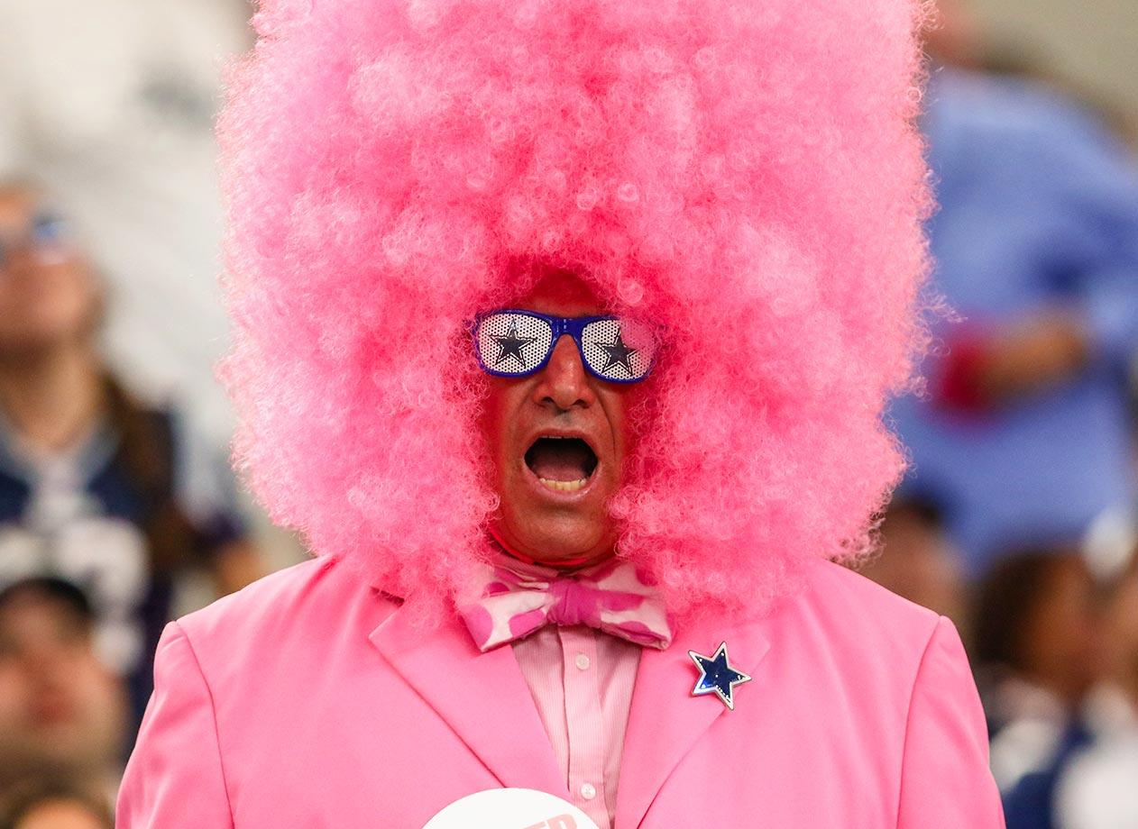 A Dallas Cowboys fan cheering at the Patriots game.  New England beats Dallas 30-6.